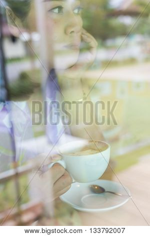 Female Drinking Hot Coffee In Cafe