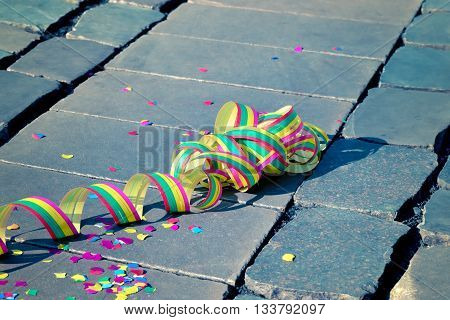 Confetti and streamers on the ground - symbol for celebration and party