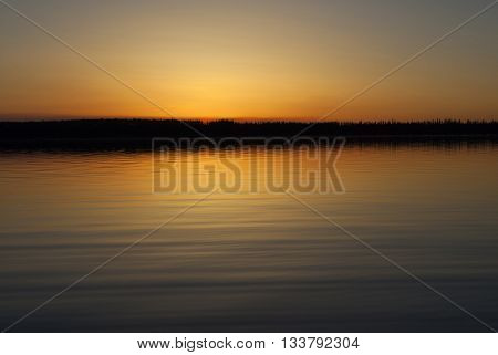 After the sun has slipped below the horizon on a lake in Saskatchewan Canada