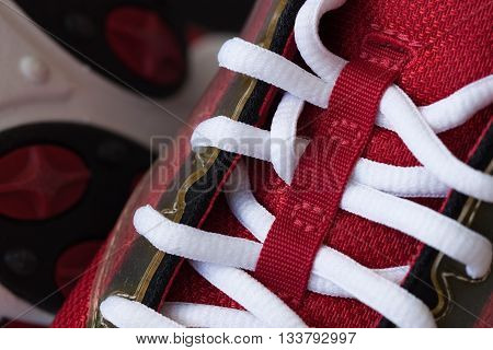 Close-up of a red sneaker with white shoelaces for background