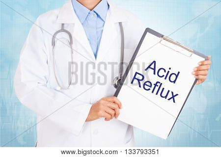 Doctor holding clipboard with acid reflux text on a sheet of paper. on white background