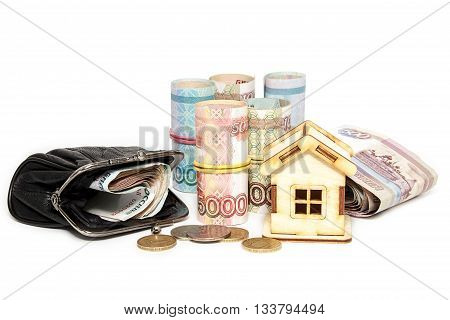 Wooden house Russian money and purse on white background