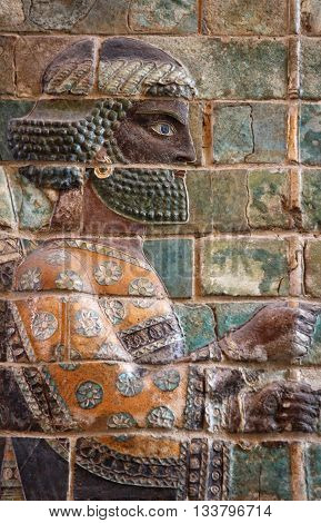 Ancient embossed colorful Achaemenid warrior from Susa of Iran.