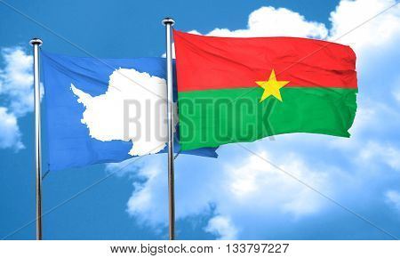 antarctica flag with Burkina Faso flag, 3D rendering
