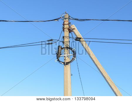 Reinforced concrete supports of overhead power lines and communication cables
