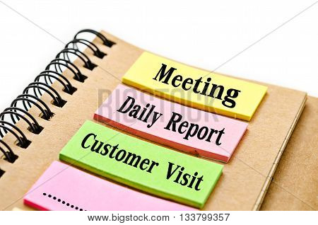 Reminder Meeting Daily report customer visit word on sticky note with diary for use in office work.