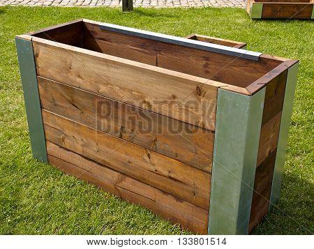 Creative modern design wooden planter on green grass
