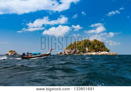 Traditional Longtail boat brings tourists to visit island around Lipe island Satun Thailand
