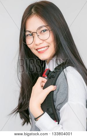 Portrait Of Happy Asian Charming With Glasses And Bagpack