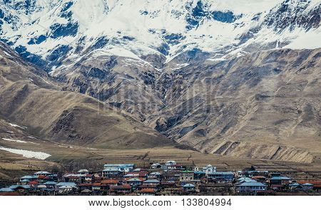 Caucasu Mountains Georgia - April 25 2015. Small village seen from Georgian Military Highway