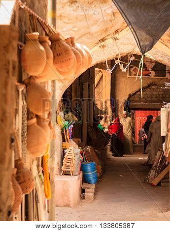 NIZWA, OMAN, MAY 27, 2016: a shopping alley at the Friday market in the old Nizwa village in Oman
