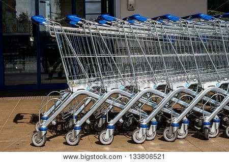 shopping cart in front of a supermarket