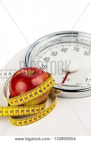 apple lying on a balance