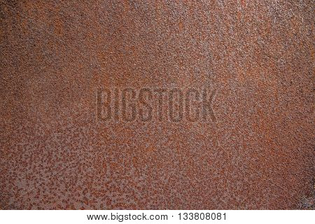 A background of peeling paint and rusty old metal. Rusty metal textured background closeup.