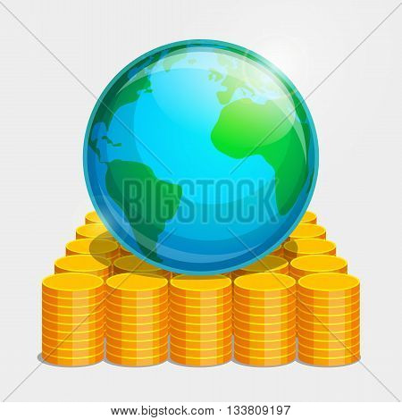 Terrestrial globe is lying on gold coins. Money as basis of stability in the world.