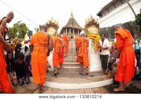 SARABURI THAILAND - AUGUST 2,2012 : Row of Monks walking to Pagoda in Tak Bat Dok Mai Festival (give flowers to monk) Ceremony at Wat Phrabuddhabat Woramahavihan Temple in Saraburi Province,Thailand.