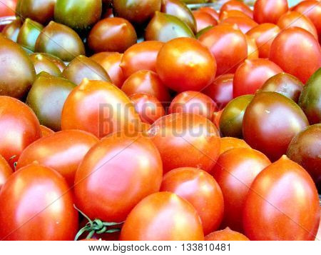 Red and brown cherry tomatoes on bazaar