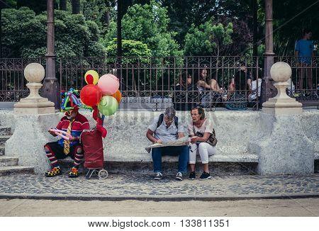 Barcelona Spain - May 22 2015. Man dressed as clown sits in Citadel (Ciutadella) Park in Barcelona