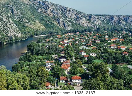 Pocitelj Bosnia and Herzegovina - August 26 2015. Aerial view on Pocitelj village in Capljina municipality with Neretva river