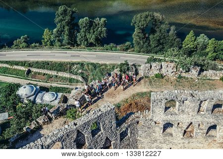 Pocitelj Bosnia and Herzegovina - August 26 2015. Tourists on the walls of 14th fortress in Pocitelj village in Capljina municipality