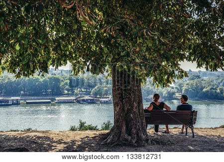 Belgrade Serbia - August 29 2015. Couple sits on a banch on promenade in Large Kalemegdan Park