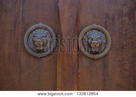 metal antique door knocker shaped like a lion's head.
