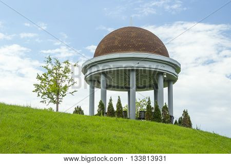 Big stone gazebo on the hill at the park.