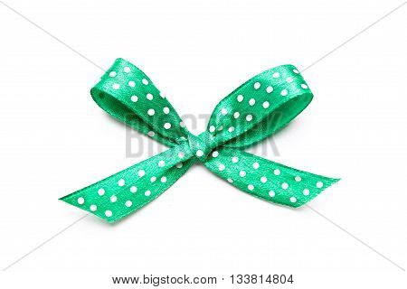 green bow with dots isolated on white background