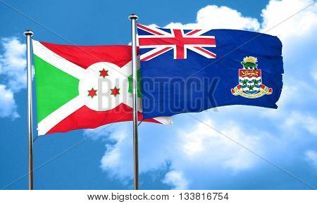 Burundi flag with Cayman islands flag, 3D rendering