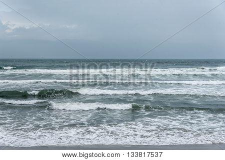Dark stormy sky and stormy sea waves.