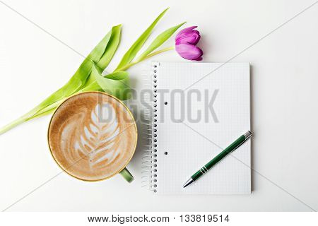 notebook with pen and coffee flat lay copy space