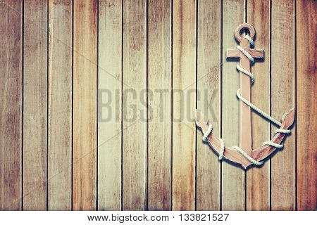 wooden anchor on wall background in vintage style