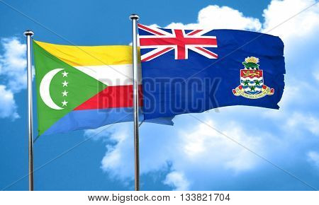 Comoros flag with Cayman islands flag, 3D rendering
