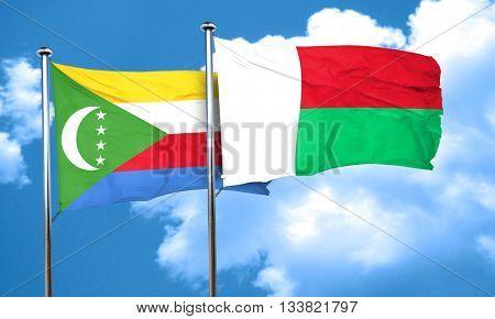 Comoros flag with Madagascar flag, 3D rendering