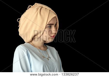 photo of the girl of the European appearance in a beautiful headdress, turban, on a dark background