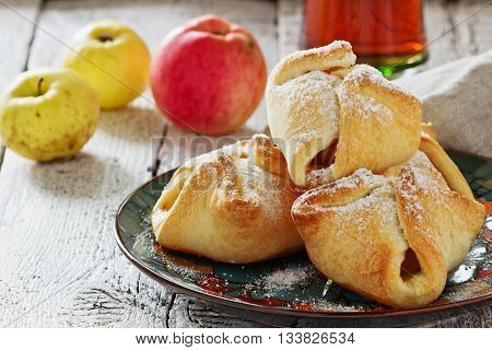 Freshly baked homemade scones with apples in a dish on the table. Homemade pastries. Selective focus