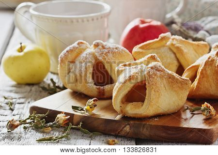 Freshly baked homemade scones on a cutting board on a table. Homemade pastries . Close-up. Selective focus