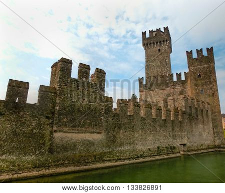 Sirmione, Italy - September 20, 2014: Lagoon in the Scaliger Castle. The famous castle of Sirmione and its small port are an uncommon example of a fortress used as a port. The building of this complex started in 1277 by Mastino della Scala.