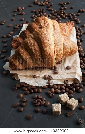 Two Fresh Baked Croissants And Coffee Beans