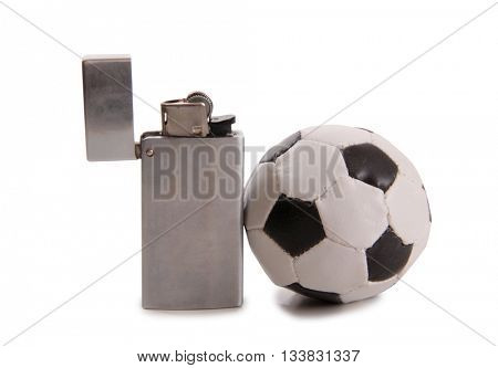 Metal lighter and ball on a white background