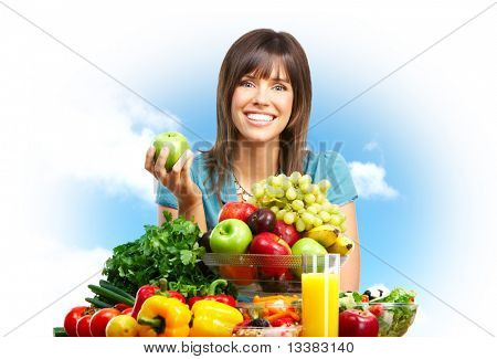 Young smiling woman,  fruits, vegetables and sky