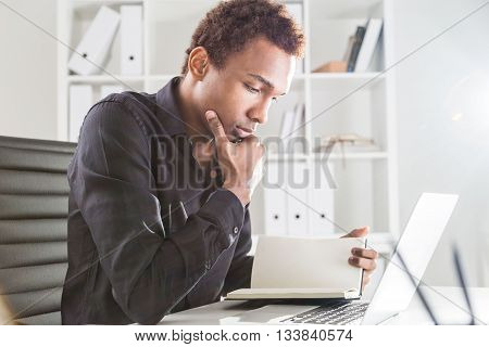 African American Businessman Reading Book