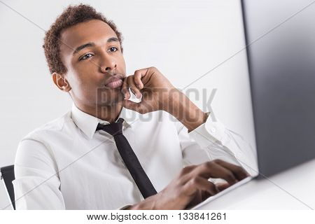 Serious Guy Using Laptop