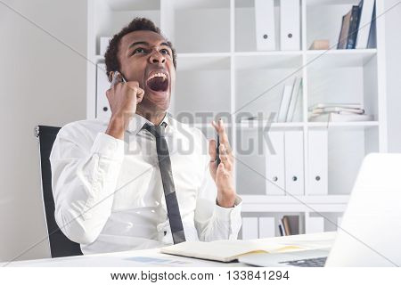 Angry Man Shouting On Phone