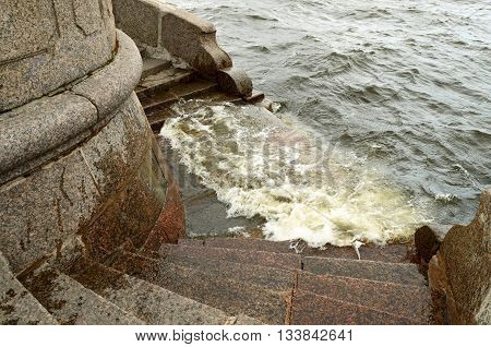 Saint-Petersburg.In the city of the river Neva.Its waters flowing along granite embankments.