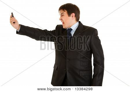 Amazed modern businessman yelling on mobile phone isolated on white