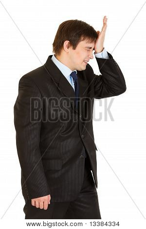 Forgot something businessman holding his hand near forehead isolated on white