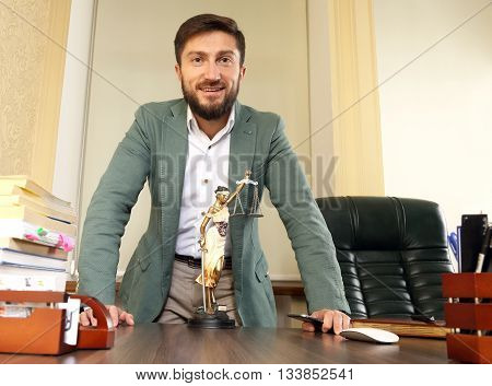 successful lawyer in the office behind the desk