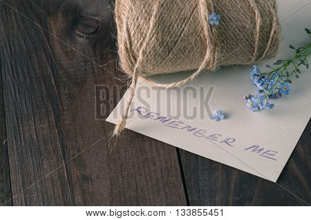 Forget me not flowers on dark wooden background