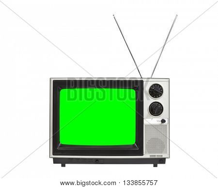 Chroma green screen portable vintage television with antennas up.  Isolated on white.